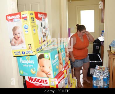 KEY WEST, Fla. (Sept. 5, 2017) A resident packs diapers and water in her Naval Air Station (NAS) Key West Sigsbee Park home in preparation for evacuation from Hurricane Irma. Non-essential personnel and dependents at NAS Key West have received mandatory evacuation orders. Essential personnel will shelter in place, manning essential functions at the air station. - Stock Photo