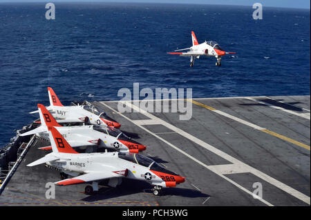 ATLANTIC OCEAN (Feb. 4, 2016) A T-45C Goshawk assigned to Carrier Training Wing (CTW) 2 lands on the flight deck of the aircraft carrier USS Dwight D. Eisenhower (CVN 69). Dwight D. Eisenhower is currently underway preparing for the upcoming Board of Inspection and Survey (INSURV) and conducting carrier qualifications. - Stock Photo