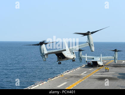 A U.S. Marine Corps MV-22B Osprey tiltrotor aircraft assigned to Marine Medium Tiltrotor Squadron (VMM) 265 takes off from the amphibious assault ship USS Bonhomme Richard (LHD 6) in the East China Sea April 11, 2014. The Bonhomme Richard was underway in the U.S. 7th Fleet area of responsibility supporting maritime security operations and theater security cooperation efforts. - Stock Photo