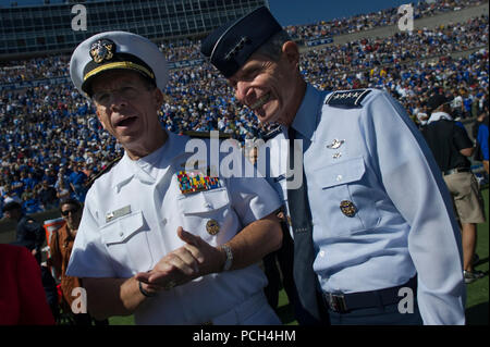 Chairman of the Joint Chiefs of Staff Adm. Mike Mullen, left, and U.S. Air Force Gen. Norton A. Schwartz, chief of staff, U.S. Air Force, meet on the Falcon Stadium field prior to kickoff of the U.S. Air Force Academy Falcons versus the U.S Naval Academy Midshipmen football game in Colorado Springs, Colo. The Falcons defeated the Midshipmen 14-6. - Stock Photo