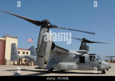 An MV-22 Osprey, from Marine Medium Tiltrotor Squadron 162, waits for supplies at U.S. Naval Station Guantanamo Bay, Jan. 24. The aircraft, scheduled to fly a mission to USS Bataan, is here in support of Operation Unified Response, providing humanitarian assistance to victims of the Jan. 12 earthquake in Haiti. - Stock Photo