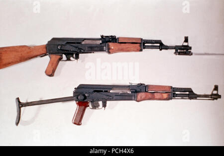 A Chinese 7.62 mm Type 56 assault rifle with a permanently attached folding bayonet, top, and a Soviet 7.62 mm AK-47 assault rifle with a folding double-strut stock. - Stock Photo