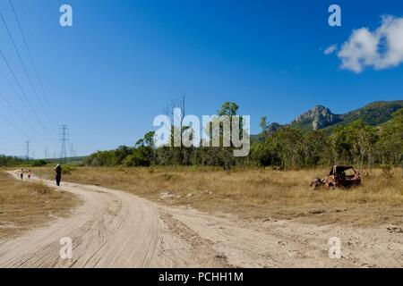 Rusted out abandoned car in a field, Townsville, Queensland, Australia - Stock Photo