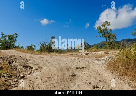 A dry dusty road in australia, Townsville, Queensland, Australia - Stock Photo