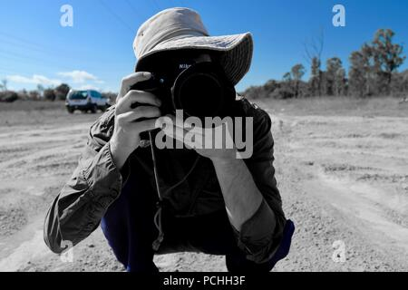 Man taking a photograph of the photographer, Townsville, Queensland, Australia - Stock Photo