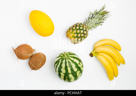 Colorful fruit pattern of pineapple, watermelon, coconut, bananas and melon on white background. Top view. Flat lay. Summer background - Stock Photo