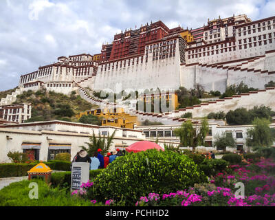 Potala Palace Front View with Garden in Lhasa, Tibet Autonomous Region. Former Dalai Lama residence, now is a museum and World Heritage Site. - Stock Photo