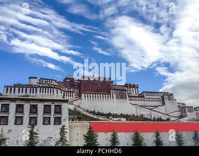 Potala Palace in Lhasa day view from town square with blue sky background, Tibet Autonomous Region. Former Dalai Lama residence, now is a museum and W - Stock Photo