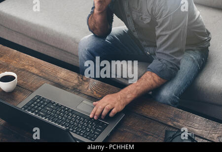 Men hands typing text on the laptop keyboard. Businessman working with laptop at home office. - Stock Photo