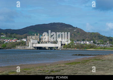 View of Conwy Castle from across the estuary of the river Conwy, North Wales, UK. A sunny spring day. - Stock Photo