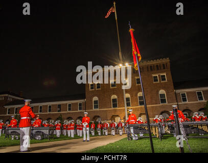 "Marines with ""The Commandant's Own,"" U.S. Marine Drum & Bugle Corps, perform a musical ballad during the Staff-Noncommissioned Officer Friday Evening Parade at Marine Barracks Washington D.C., July 27, 2018. During the SNCO Friday Evening Parade, SNCO's assume the billets of key leaders' marching positions normally filled by officers and non-commissioned officers. - Stock Photo"
