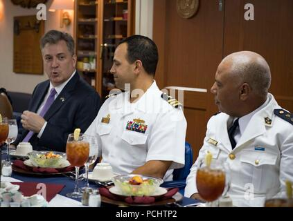 180728-N-UY653-317  ALGIERS, Algeria (July 29, 2018) Cmdr. Tyson Young, center, commanding officer of the Arleigh Burke-class guided-missile destroyer USS Carney (DDG 64), speaks with John Desrocher, U.S. ambassador to Algeria, during the ship's visit to Algiers, Algeria, July 29, 2018. Carney, forward-deployed to Rota, Spain, is on its fifth patrol in the U.S. 6th Fleet area of operations in support of regional allies and partners as well as U.S. national security interests in Europe and Africa. (U.S. Navy photo by Mass Communication Specialist 1st Class Ryan U. Kledzik/Released) - Stock Photo