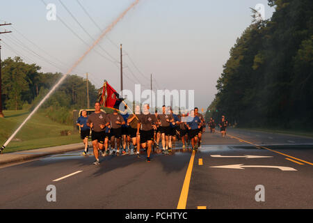 "Maj. Gen. Erik Kurilla (front, left), outgoing commander of the 82nd Airborne Division, and Command Sgt. Maj. Michael Ferrusi, (front, right), 82nd Airborne Division command sergeant major, lead the ""All American"" division during a division run down Longstreet July 27, 2018 on Fort Bragg, North Carolina. The paratroopers of the division enjoyed Warrior Games and an early release from work after the run. - Stock Photo"