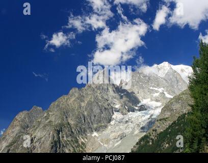 Mont Blanc with the Aiguille Noir du Peuterey ridge and glacier - Stock Photo