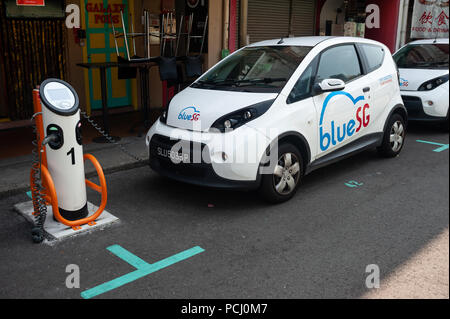 04.04.2018, Singapore, Republic of Singapore, Asia - A Blue SG electric vehicle (EV) is recharged at a charging station in Chinatown. - Stock Photo