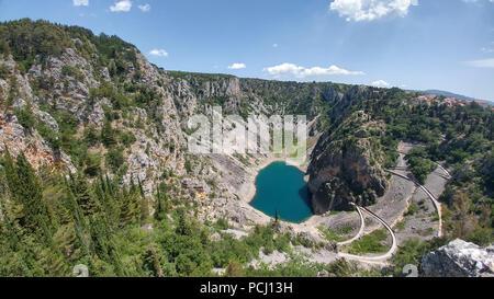 Blue Lake (Croatian: Modro jezero or Plavo jezero) is a karst lake located near Imotski in Croatia. It lies in a deep collapse sinkhole. - Stock Photo