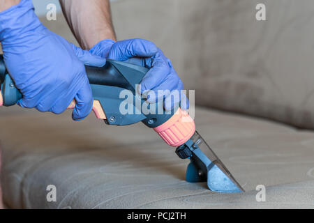Closeup of upholstered Sofa chemical cleaning - Stock Photo