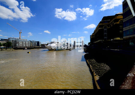 Silver Wind cruise ship moored next to HMS Belfast on the River Thames, London, England, UK. August 2018 Tower Bridge behind - Stock Photo