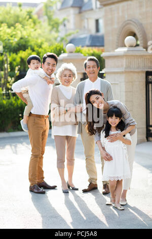 Portrait of happy Chinese family - Stock Photo