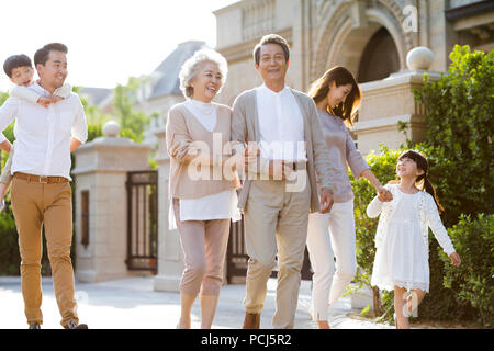 Happy Chinese family strolling outside