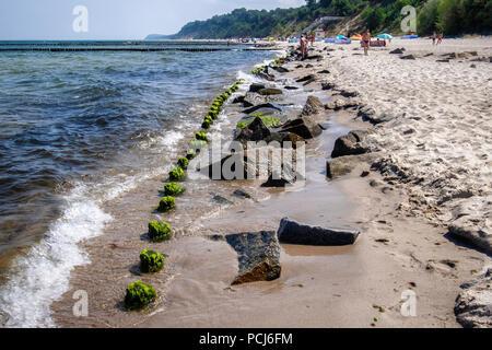 Germany Loddin,Stubbenfelde Beach.Coastal bathing resort on the island of Usedom on the Baltic Sea. Rocks & wood groyne prevent erosion of sandy beach - Stock Photo