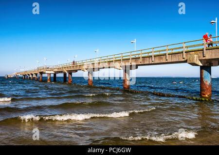 People walking on Bansin beach pier at the Baltic sea resort on Usedom Island , Heringsdorf, Germany - Stock Photo