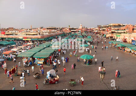 MARRAKECH, MOROCCO. 27 August, 2017: Local people, tourists and street vendor walking in the main square of Marrekesh Medina, called Jemaa el-Fnaa - Stock Photo