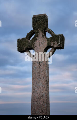 Duchess Cross granite memorial to Elizabeth Duchess of Argyll at dusk on Isle of Iona Inner Hebrides Scotland UK - Stock Photo