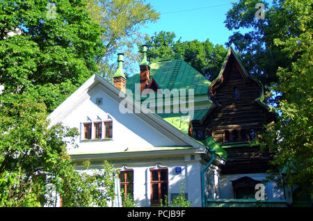 ancient wooden house in Moscow in summer, Olympic Avenue - Stock Photo