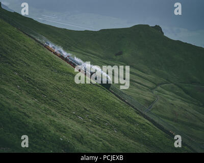 old steam train on a mountain track in the swiss alps, brienzer rothorn bahn in switzerland - Stock Photo