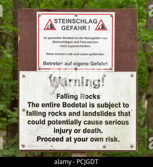 Warning sign of falling rocks and landslides at the entrance of the Bodetal near Thale, Harz. (German text identical to English text) - Stock Photo