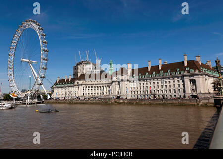 Wide-Angle view of The London Eye  and the former  London County Hall Building, as seen from Westminster Bridge, London - Stock Photo