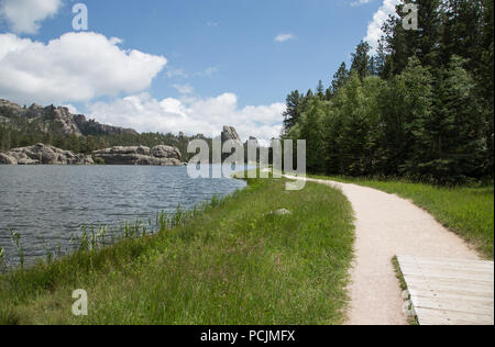 Walking Path along mountain lake - Stock Photo
