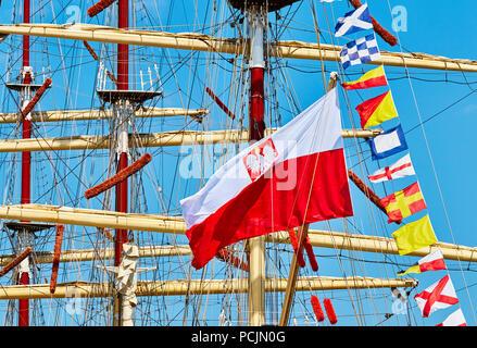 Polish flag on a sailing ship mast. - Stock Photo