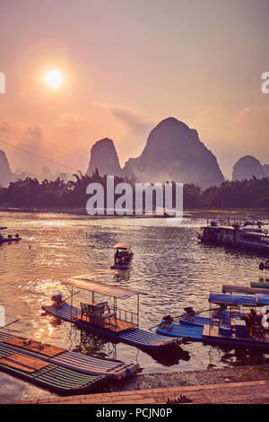 Scenic sunset over Li River in Xingping, color toning applied, China. - Stock Photo