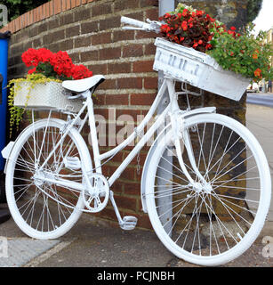 Hunstanton in Bloom, unusual plant container, white painted bicycle - Stock Photo