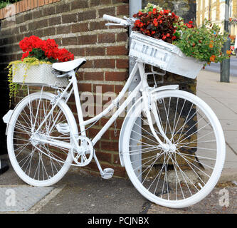 Hunstanton in Bloom, unusual plant container, yellow painted bicycle - Stock Photo