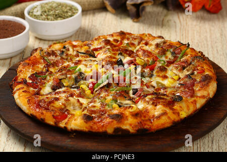 Delicious italian pizza on the wood table - Stock Photo