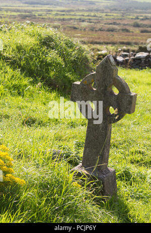 A Celtic cross at St. Brandon's Church on the Dingle Peninsula, County Kerry, Ireland - Stock Photo