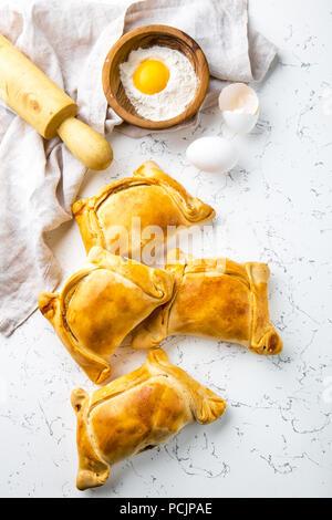 Chilean EMPANADAS DE PINO. Independence day baking concept. Empanadas on white background. - Stock Photo