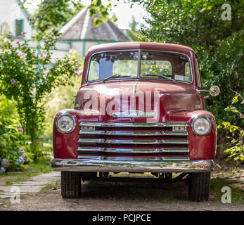 old red Chevrolet pick up truck - Stock Photo