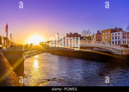The Liffey Bridge over the river Liffey at sunset, Dublin Ireland, March 2018 - Stock Photo