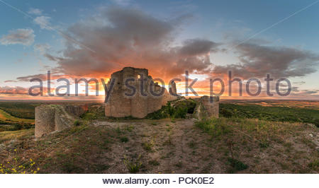 Sunset over The Castle of Almenara,Cuenca,Spain - Stock Photo