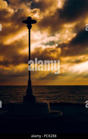 lamppost against dark - Stock Photo