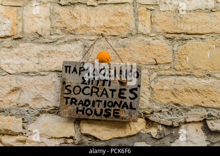 Omodos, Cyprus. May 2018. A sign for a local house known as Socrates House, which is now a museum in the traditional village of Omodos in Cyprus. - Stock Photo