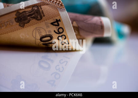 Indian currency notes of Rupees Ten isolated background - Stock Photo