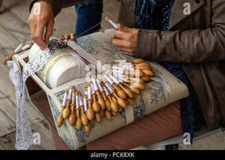Lace making in the city of Le Puy-en-Velay in the Auvergne-Rhone-Alpes region of south-central France. Lace is a delicate fabric made of yarn or threa - Stock Photo