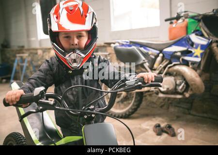 Kid prepare for bike ride - Stock Photo