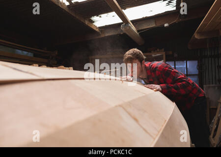 Male carpenter working in workshop - Stock Photo