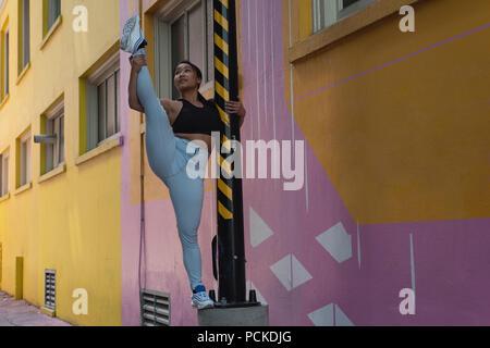 Female street dancer on the pole - Stock Photo